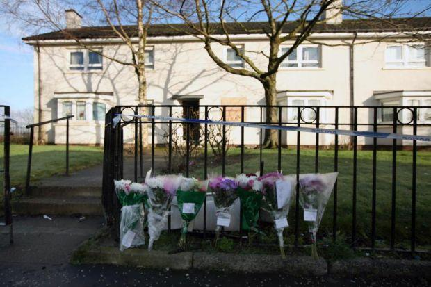 Floral tributes outside  Quarrywood Avenue in Barmulloch, where the body of 48-year- old Angela Humphrey was found. Picture: Colin Templeton