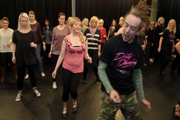 Dirty Dancing cast member James Bennett shows reporter Catriona Stewart some of the moves. Pictures: Mark Mainz