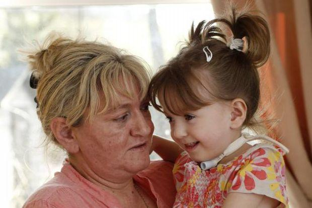 Lily, with mum Vivien Kelly, has not been at nursery full time since October