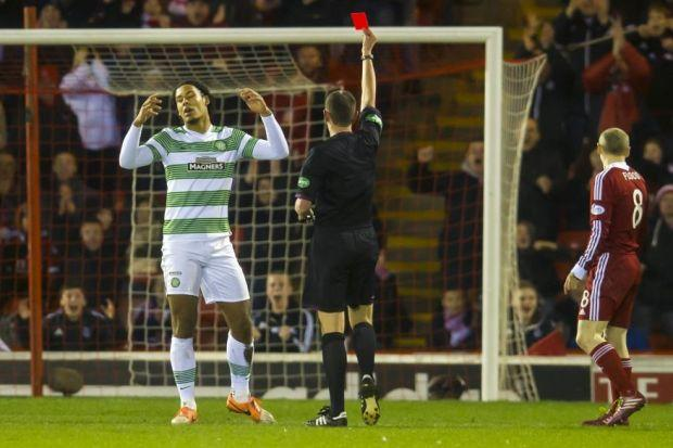 Referee Craig Thomson sends off Celtic defender Virgil van Dijk against Aberdeen