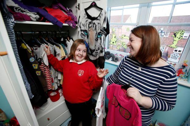 Lauren Holland and her mum, Kirsty, go through her wardrobe to donate clothes to the collection
