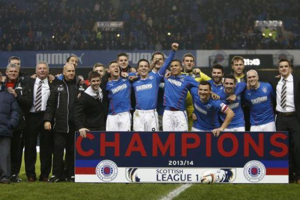 Ally McCoist joins the Rangers squad to celebrate League One title success. Picture: Colin Mearns