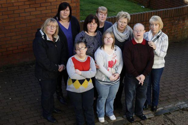 Families left struggling after the closure of a day centre include, left to right, back row: Helen McCourt, Kim Kenny, Grace Harrison, Mary McArthur, Terri McCue, George Crone, Maureen Crone.  Front row: Cheryl McArthur, Laura McCourt. Picture: Colin Temp