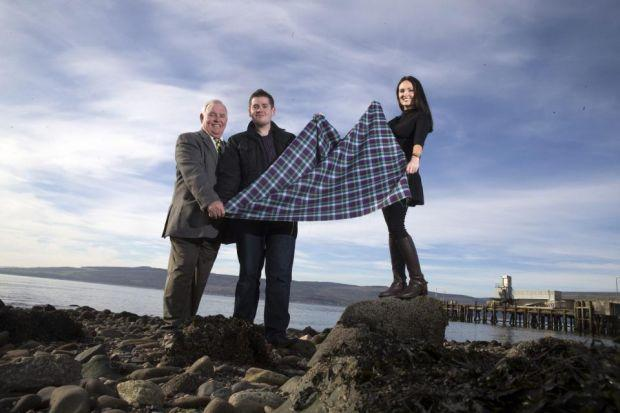 Enable volunteers Charlie Newlands, left and Joanna Doyle show off thet tartan to  Sean Baxter