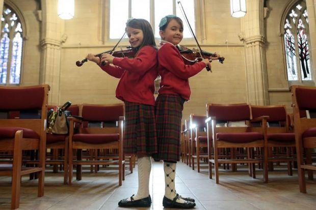 Young violinists Ariana Pignatiello and Sara Charnley, both 8, from Glasgow's Gaelic School, were among the more  than 7000 performers in the annual music festival