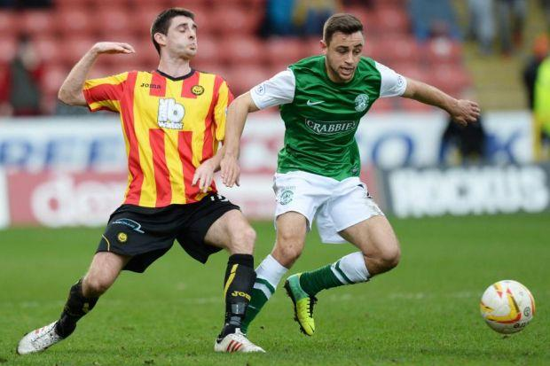 Partick Thistle's Kris Doolan tussles with Tom Taiwo of Hibs as the Firhill side kept up their decent form with a 3-1 victory