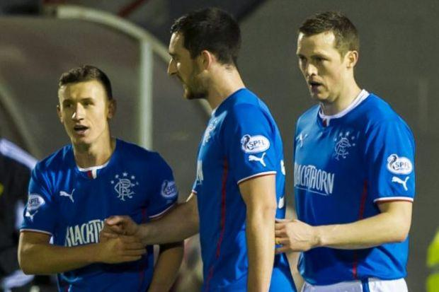 Fraser Aird (left) is congratulated by Lee Wallace and Jon Daly (right) after opening the scoring for Gers against Albion Rovers