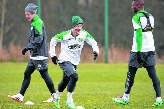 Leigh Griffiths, centre, was in good spirits with his team-mates at training yesterday