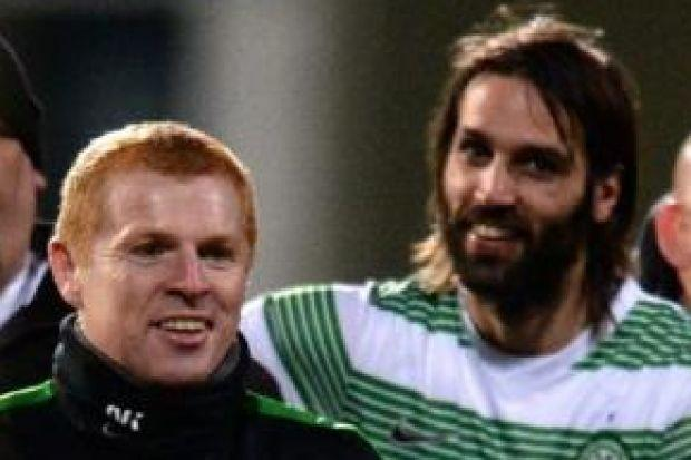 Kris Commons celebrates with Georgios Samaras after the Greek's goal secured Celtic's first Champions League win on the road at Spartak Moscow