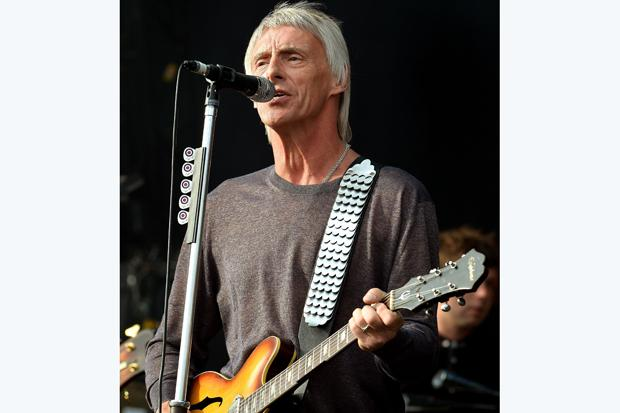 Singer Paul Weller wins £10,000 privacy damages over photos of his children
