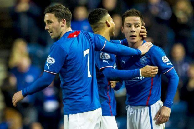Ian Black celebrates his wonder strike with Nicky Clark and Arnold Peralta