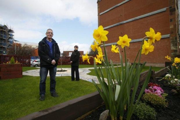 Jim Fraser and Janet Miller, both with EHA, helped to create in the Ibrox Flower Field                        Picture: Colin Mearns