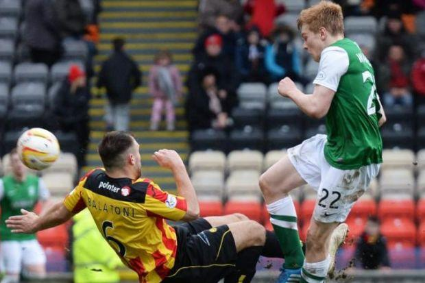 Conrad Balatoni blocks a shot from Hibernian's Duncan Watmore during last month's match