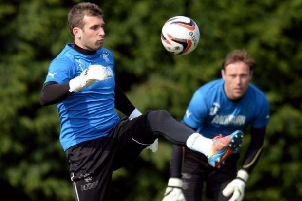 Rangers keeper Cammy Bell shows off his keepy-uppy skills at training as fellow keeper Steve Simonsen looks on