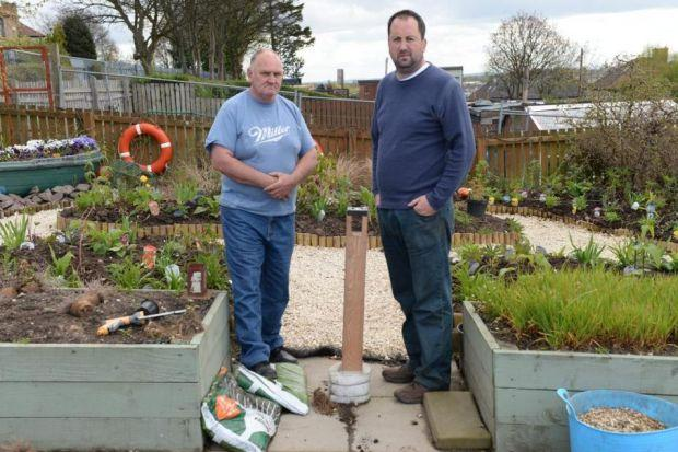 Frank McGregor, left, and Robert Gray, who help maintain the school allotment, as well as having their own. Pictures: Nick Ponty