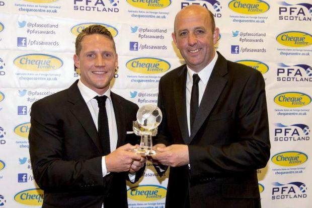 Kris Commons receives his SPFL Premiership Player of the Year award from Gary McAllister