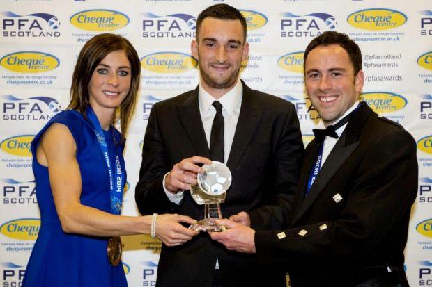 Lee Wallace receives his League One Player of the Year award from Scots curlers Eve Muirhead and David Murdoch