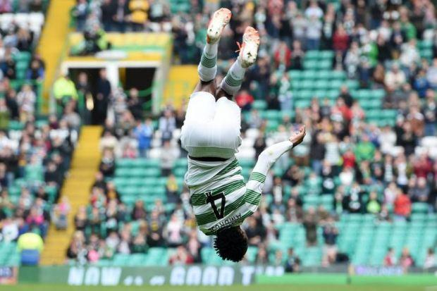 Efe Ambrose celebrates in his trademark style