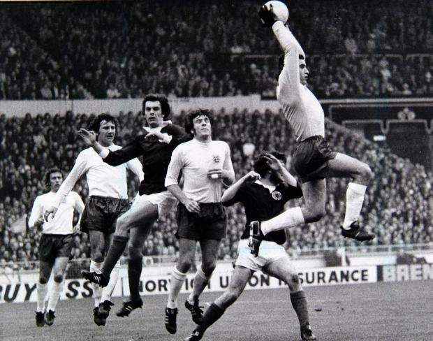 Peter Shilton easily collects a high ball as, from left, Martin Chivers, Roy McFarland, Joe Jordan, Emlyn Hughes and Derek Johnstone look on at Wembley in 1973
