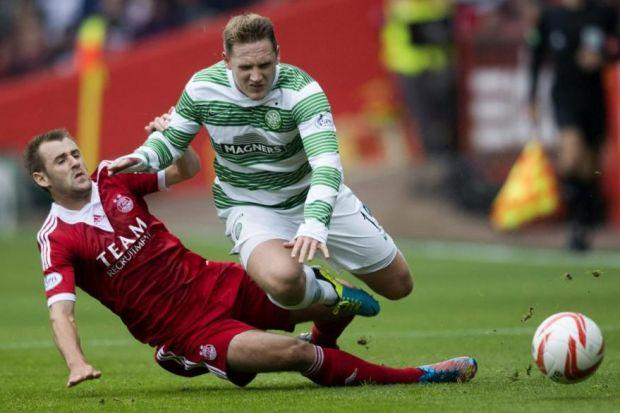 Niall McGinn tussles with Celtic's Kris Commons