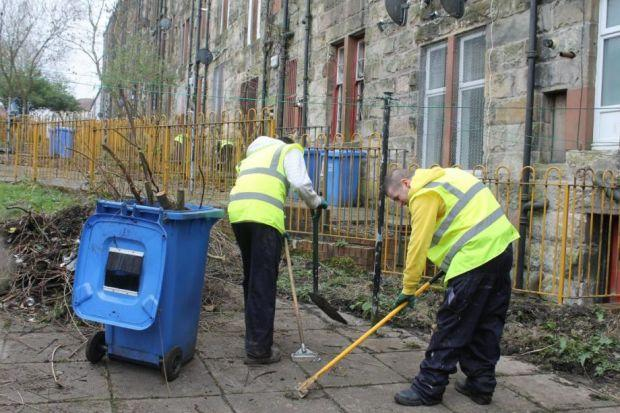 Offenders cleaning up back courts in the Alexandra Park area in Glasgow