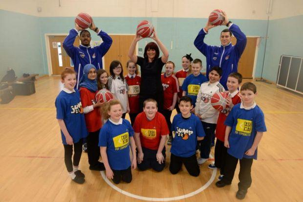 Natalie Phillips, centre, with Glasgow Rocks players and P7 kids from Dalmarnock Primary School  Picture:  Nick Ponty