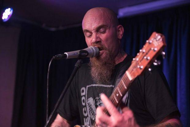 Nick Oliveri, left, with Queens Of The Stone Age