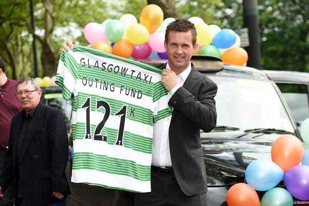 Hoops boss Deila joins taxi drivers and children as they head off on charity trip