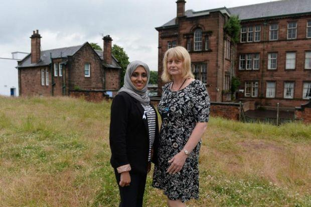 Govanhill councillor Soryia Siddique and headteacher Hilda Carrick on the disused land                     PIcture: Nick Ponty