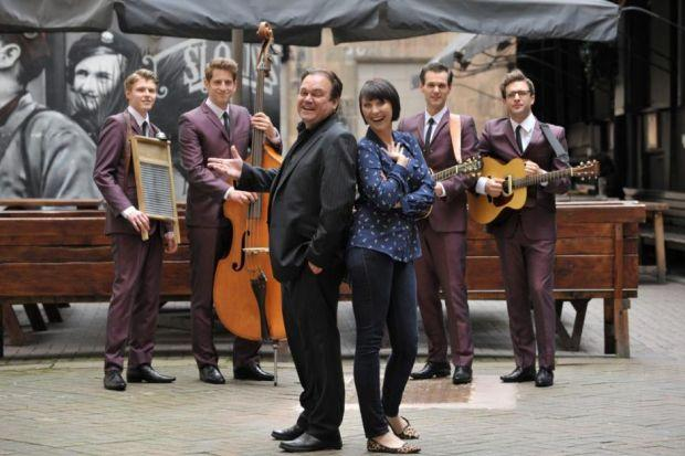 Shaun Williamson with his co-star  Emma Barton and the band The Craze, who are all in One Man Two Guvnors at the King's Theatre this week. Picture: Nick Ponty