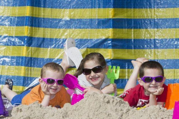 Brothers Morgan, 4, and Thomas Parkes, 6, are joined by their big sister Rebecca, 8, for a sneak preview of the city beach   Picture: Mark Gibson