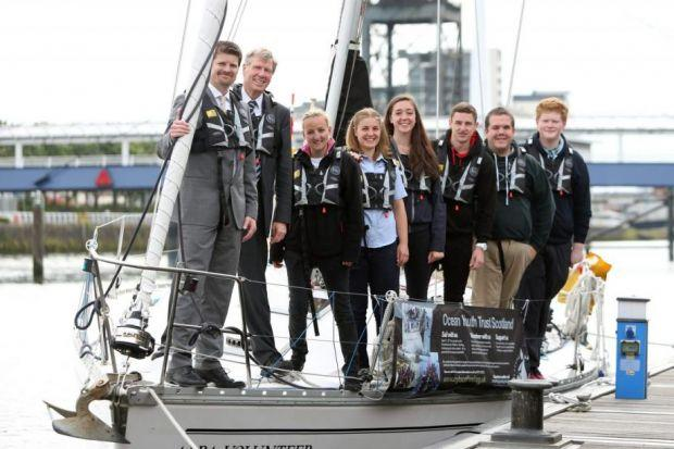 Trust chief executive Dominic McKay joined Kenny MacAskill and some young sailors to launch the training schemePicture: Colin Templeton