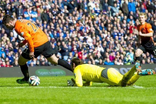 Nadir Ciftci goes round Rangers' Steve Simonsen, after an error by the keeper, to score during Dundee United's 3-1 Scottish Cup semi-final win last season at Ibrox