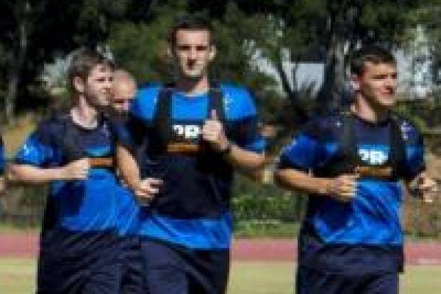 David Templeton, left, Lee Wallace and Lee McCulloch down to work in the Californian sun