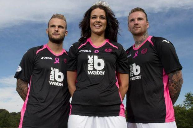 Top of the kit parade...Kallum Higginbotham and Ryan Stevenson model Thistle's new away strip in tandem with Breast Cancer Care Scotland alongside Miss West End Keri Mattinson