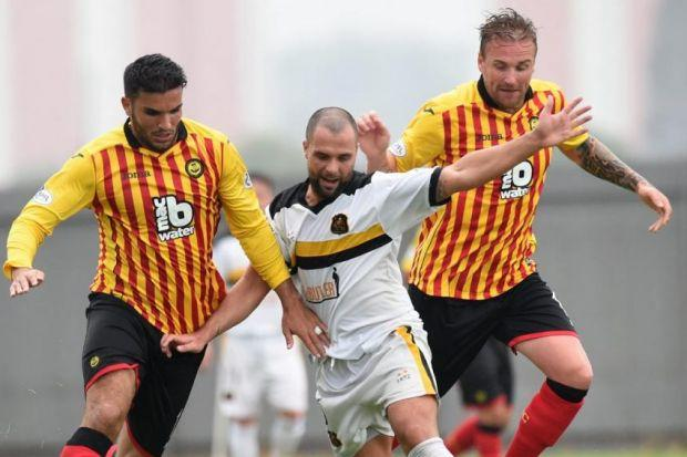 Dumbarton's Chris Turner is closed down by Partick Thistle trialist Hamza Bencharif and goalscorer Ryan Stevenson