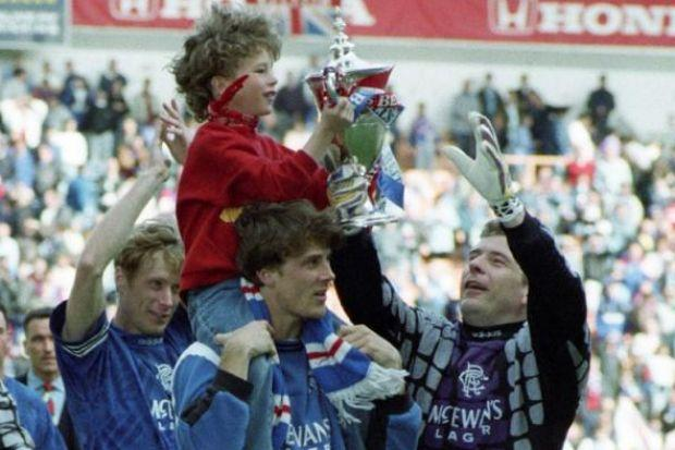 Brian Laudrup's son passes the championship trophy to Andy Goram in 1995