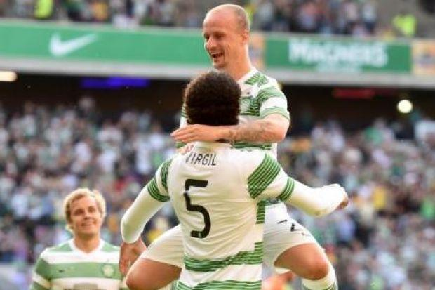 Leigh Griffiths congratulates goalscorer Virgil van Dijk on his opening goal in Celtic's 4-0 win against KR Reykjavic on Tuesday night