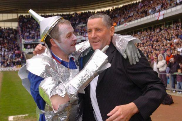 Metal as anything … McMinn laughs with a fan dressed as his Tin Man namesake at his 2006 testimonial in Derby