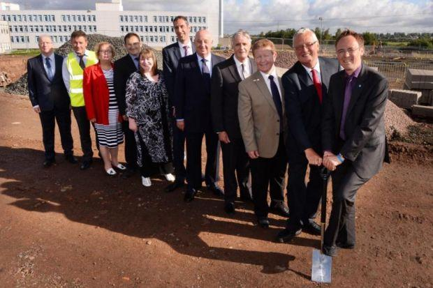 Minister for Learning Alasdair Allan, far right, dug the first turf
