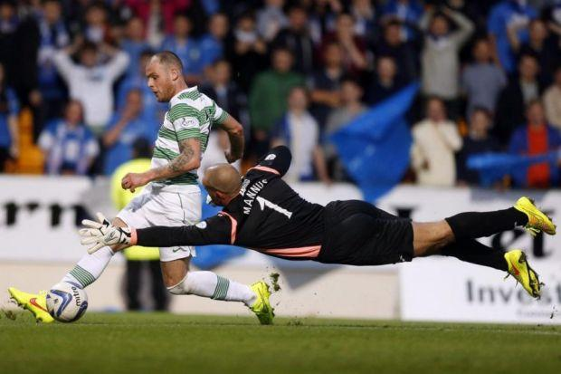 Anthony Stokes rounds Alan Mannus to put Celtic ahead 10 minutes after the break