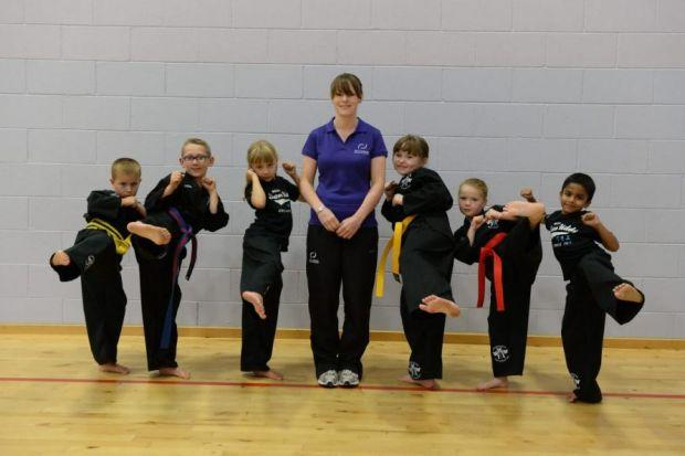 Fiona Mathie, local ­community sports hub officer, with taekwondo club members, Robert Brandon, Dom Mccauley, Emma Melrose, Sophie Brown, Louisa Gilluley and Sirish Vimal. Picture: Nick Ponty
