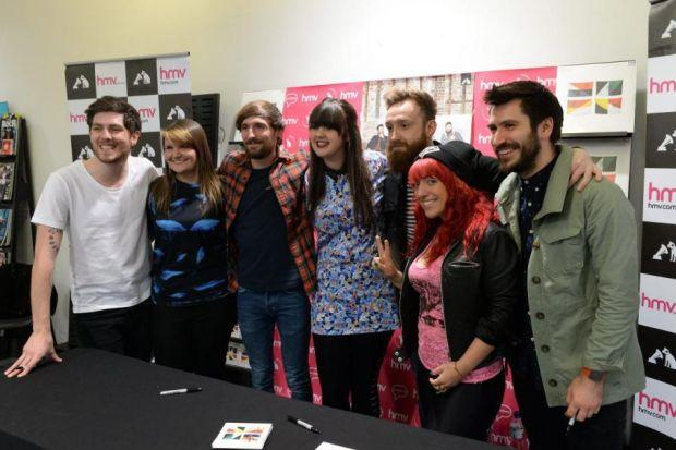 Twin Atlantic pose with three happy fans - Emma Scott, Nadine Prow and Rebecca Stodart - after signing copies of their new album Great Divide at HMV.  Picture: Nick Ponty
