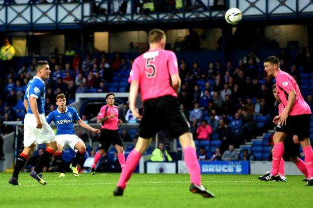 Lewis Macleod scores the first of his two goals on the stroke of half-time