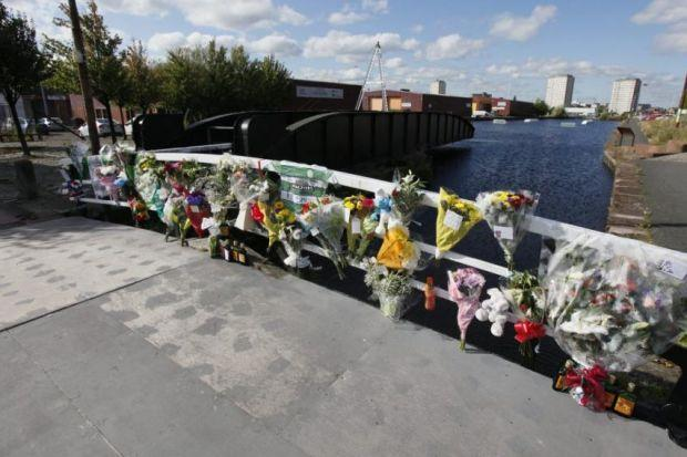 Floral tributes were left by the canal.