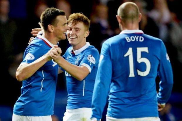 Lewis Macleod (centre) congratulates skipper Lee McCulloch after he scored against Clyde in the Petrofac Training Cup