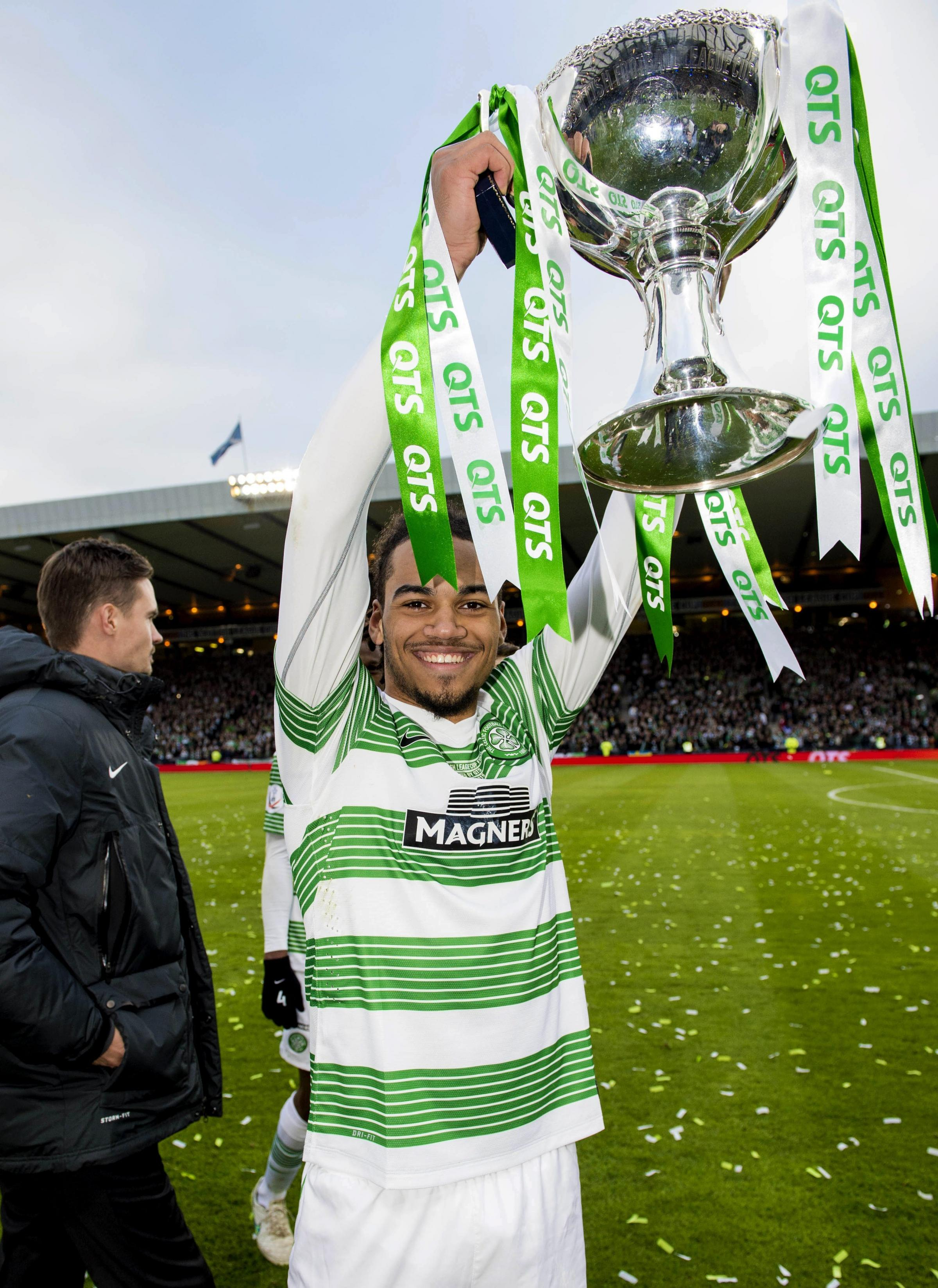 Jason Denayer proudly shows off the QTS League Cup trophy after the 2-0 victory over Dundee United