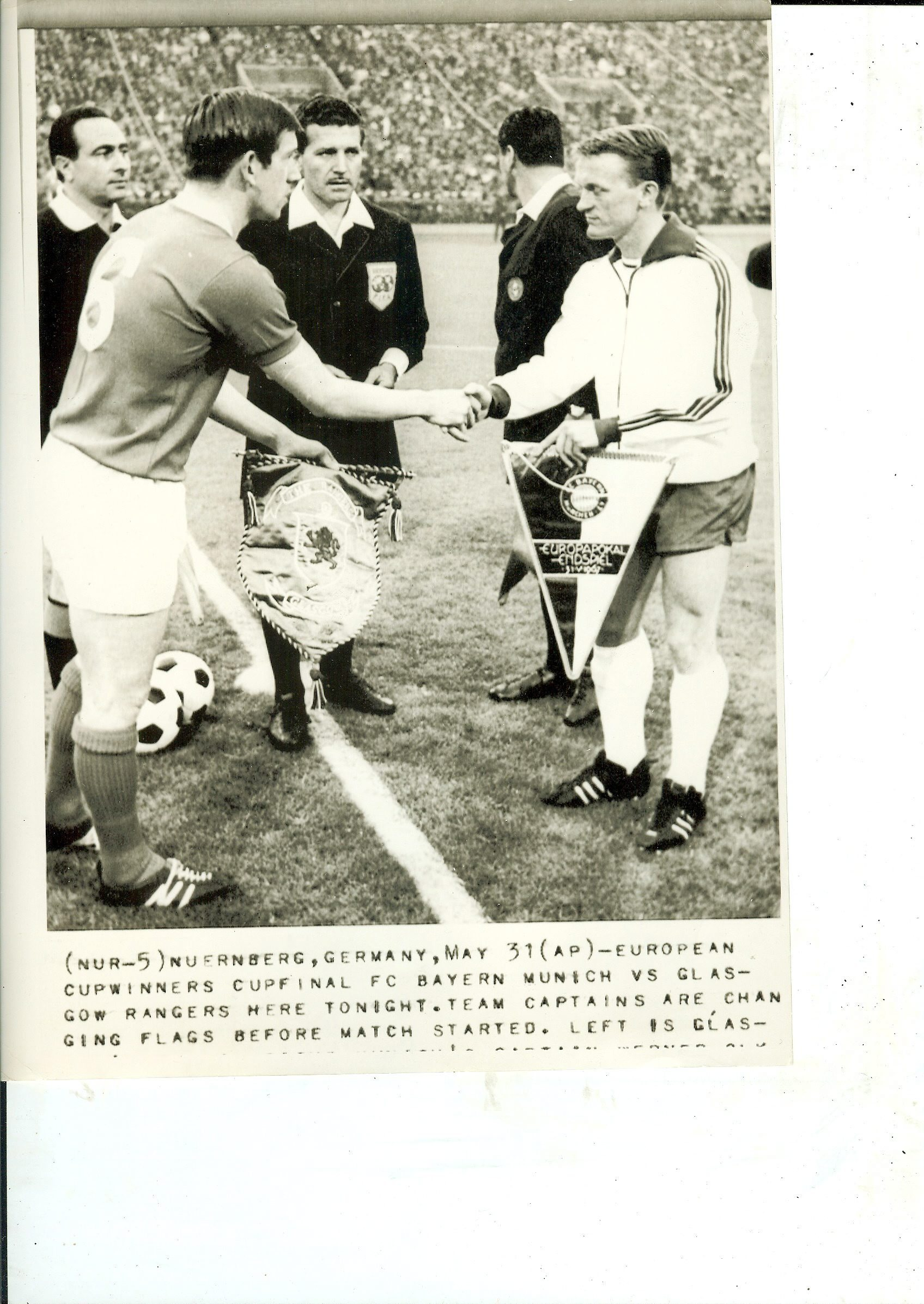 John Greig shakes hands and exchanges pennants with Bayern Munich captain Werner Olk