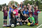 Tinto play initiative organised by Aberlour Youth Point Glasgow at Tinto primary school. Pictured are kids with Celtic and Rangers community coaches, Dan Macdonald (community coach Celtic FC foundation) and Rangers community coach Scott Edgar. Other grown