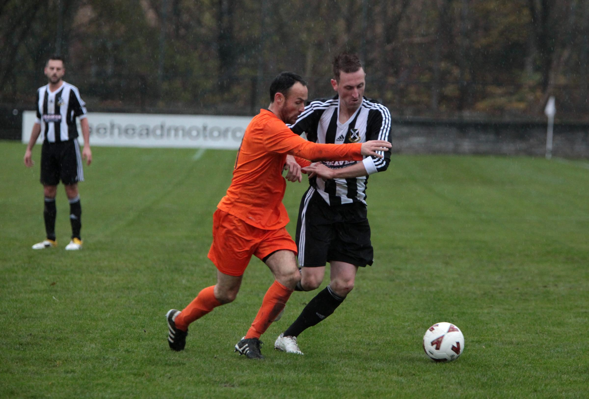 Pollock FC v Yoker FC at Newlandsfield ; David Winters Pollock holds off Yoker player 8/11/14. (39699780)